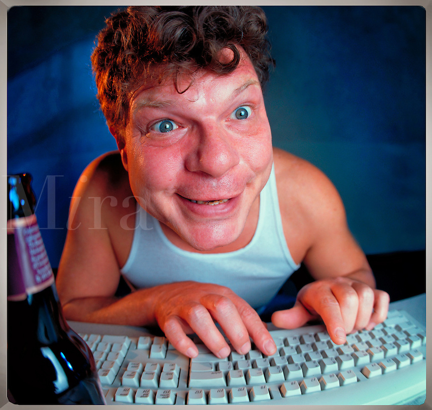 Creepy guy in tee shirt with beer indulging in late-night chat room  banter. Billboard and broadcast must be negotiated, due to talent agreement.
