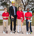 Chaolin Chang poses for a photograph with fourth grade students during a groundbreaking ceremony for the new Mandarin Chinese Language Immersion Magnet School, December 6, 2014.