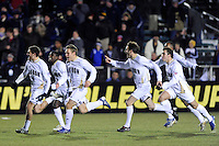 Akron Zips players including Chris Korb (16), Stefan Ostergren (19), and C.J. Kaufman (8) celebrate defeating the North Carolina Tar Heals in a penalty kick shootout. The Akron Zips defeated the North Carolina Tar Heals 5-4 in penalty kicks after playing a scoreless game during the second semi-final match of the 2009 NCAA Men's College Cup at WakeMed Soccer Park in Cary, NC on December 11, 2009.