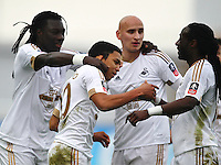 Jefferson Montero of Swansea celebrates scoring the opening goal with team-mates   during the Emirates FA Cup 3rd Round between Oxford United v Swansea     played at Kassam Stadium  on 10th January 2016 in Oxford