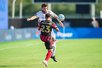 LAKE BUENA VISTA, FL - JULY 16: Mathieu Deplange #17 of FC Cincinnati and Jake Mulraney #23 of Atlanta United battle for the ball during a game between FC Cincinnati and Atlanta United FC at Wide World of Sports on July 16, 2020 in Lake Buena Vista, Florida.