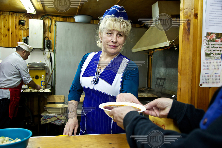 The cooks are the only women on site at the oil and gas prospecting company Siesmorevzedka's isolated camp in the Arctic tundra. /Felix Features
