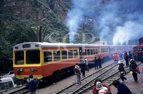 Machu Pichu Station, Peru. Machu Pichu Railway - autowagon tourist train; people getting on and off.