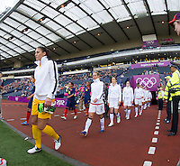 Glasgow, Scotland - Saturday, July 28, 2012: Hope Solo of the USA Women's soccer team walks onto the field during a 3-0 win over Colombia in the first round of the Olympic football tournament at Hamden Park.