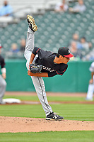 Birmingham Barons starting pitcher Bernardo Flores (30) delivers a pitch during a game against the Tennessee Smokies at Smokies Stadium on May 15, 2019 in Kodak, Tennessee. The Smokies defeated the Barons 7-3. (Tony Farlow/Four Seam Images)