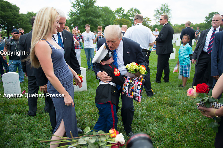 President Donald J. Trump and Vice President Mike Pence talk with Christian Jacobs, 6, and his mother Birttany at the grave of his father in Section 60 of Arlington National Cemetery, Arlington, Va., May 29, 2017.  Christian visits with his mother, Brittany, every year for Memorial Day.  (U.S. Army photo by Elizabeth Fraser/Arlington National Cemetery/released)