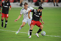 WASHINGTON, DC - AUGUST 25: Junior Moreno #5 of D.C. United battles for the ball with Adam Buska #9 of New England Revolution during a game between New England Revolution and D.C. United at Audi Field on August 25, 2020 in Washington, DC.