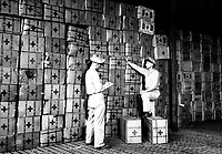 Red Cross field men preparing to ship gift boxes to servicemen fighting on Leyte and other islands in the Philippines.  Efforts are being made to assure each man a gift package on Christmas Day.  New Guinea, November 20, 1944.  American Red Cross.  (OWI)<br /> NARA FILE #:  208-AA-324A-1<br /> WAR & CONFLICT BOOK #:  850
