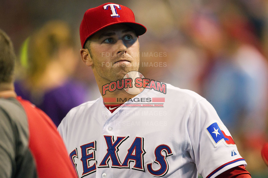 Texas Rangers rookie Mike Olt #9 in the dugout during the Major League Baseball game against the Baltimore Orioles on August 21st, 2012 at the Rangers Ballpark in Arlington, Texas. The Orioles defeated the Rangers 5-3. (Andrew Woolley/Four Seam Images).