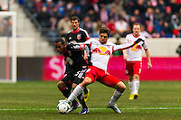 Marcos Sanchez (25) of D. C. United and Juninho (8) of the New York Red Bulls battle for the ball. The New York Red Bulls and D. C. United played to a 0-0 tie during a Major League Soccer (MLS) match at Red Bull Arena in Harrison, NJ, on March 16, 2013.