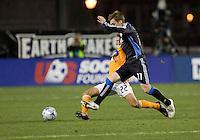 Stuart Holden (22) slide tackles Bobby Convey (11). San Jose Earthquakes defeated Houston Dynamo 3-2 at Buck Shaw Stadium in Santa Clara, California on March 28th, 2009.