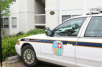 Police cars were parked outside the apartment building where UVa women's lacrosse player Yeardley Love, 22, a fourth-year student from Cockeysville, Md., was allegedly murdered by Virginia men's lacrosse player George Huguely, 22, a fourth-year student from Chevy Chase, Md., Monday May 3, 2010 in Charlottesville, Va. The alleged incident happened early Monday morning in the Yeardley's apartment located near the University of Virginia. Photo/Andrew Shurtleff