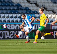 12th September 2020 The John Smiths Stadium, Huddersfield, Yorkshire, England; English Championship Football, Huddersfield Town versus Norwich City;  Christopher Schindler (C) of Huddersfield Town plays the ball forward