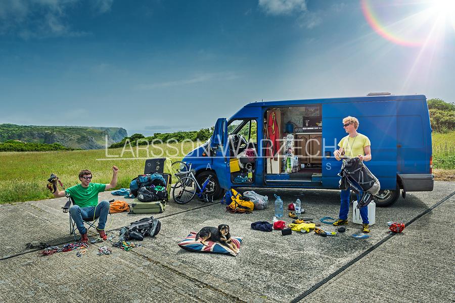 James Taylor, Tom Livingstone and Rosie pose for a portrait in front of James' van, Pembroke