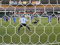 DC United defender Julius James (2) head the ball against El Salvador National Team goalkeeper Dagoberto Portillo (1)   DC United defeated El Salvador National Team 1-0 in a international charity match at RFK Stadium, Saturday June 19, 2010.