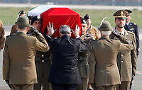 Il Ministro della Difesa Giampaolo Di Paola pone le mani sulla bara del sergente Michele Silvestri, ucciso in Afghanistan, all'aeroporto militare di Ciampino, Roma, 26 marzo 2012..Italian Defense Minister Giampaolo Di Paola pays his respect to the coffin of the sergeant Michele Silvestri, killed in a mortar attack in Afghanistan, at Ciampino military airport near Rome, 26 february 2012..UPDATE IMAGES PRESS/Riccardo De Luca