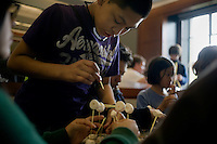 Middle school students in the Tenacity after-school program in East Boston build structures out of spaghetti and marshmallows as part of a demonstration by the Department of Mechanical Engineering during the MIT Under the Dome open house in Cambridge, Massachusetts, USA.