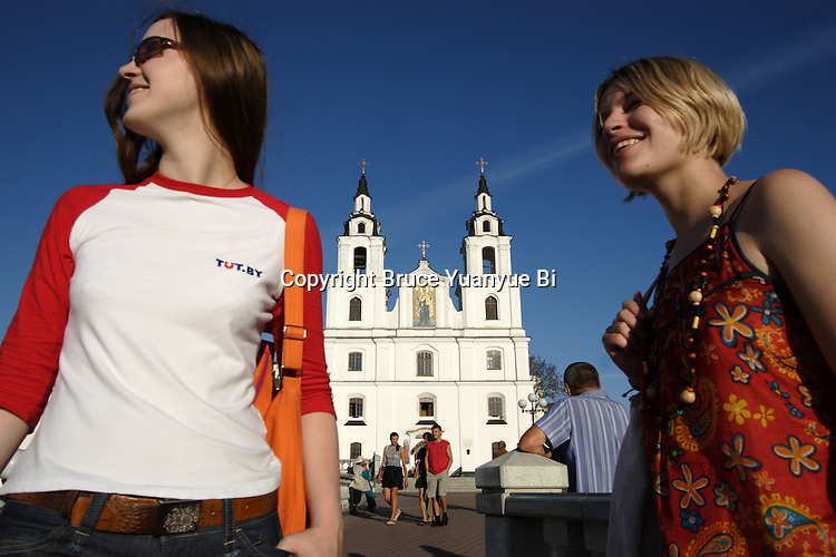 Local young women outing in front of Holy Spirit Cathedral. Minsk. Belarus
