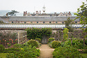 Rose garden and rear of greenhouse, Parham, mid May.