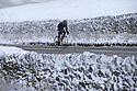 14/01/16<br /> <br /> Buxton Cycling Club member, Arne Beswick, braves the cold as he passes snow-covered dry stone walls after cycling to the top of Mam Tor in the Derbyshire Peak District near Edale. To keep warm Arne added a pair of football socks to his usual winter gear.<br /> <br /> All Rights Reserved: F Stop Press Ltd. +44(0)1335 418365   +44 (0)7765 242650 www.fstoppress.com