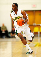 30 January 2010: University of Vermont Catamount guard Garvey Young, a Sophomore from Washington, DC, in action against the University at Albany Great Danes at Patrick Gymnasium in Burlington, Vermont. The Catamounts defeated the Danes 64-46 in the America East matchup. Mandatory Credit: Ed Wolfstein Photo