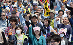 May 1, 2013, Tokyo, Japan - Participants raise their clenched-fists in a May Day rally sponsored by the National Confederation of Trade Unions at a Tokyo park on Wednesday, May 1, 2013. Some 32,000 people took part in the rally, voicing their concerns for tax hike and constitutional revision among other things.  (Photo by Natsuki Sakai/AFLO)