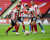 31st October 2020; Bramall Lane, Sheffield, Yorkshire, England; English Premier League Football, Sheffield United versus Manchester City; Ethan Ampadu of Sheffield United breaks with the ball from his goal area
