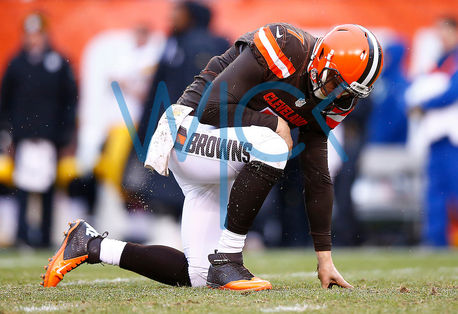 Austin Davis #7 of the Cleveland Browns sits on the grass after being hit by James Harrison #92 of the Pittsburgh Steelers during the game at FirstEnergy Stadium on January 3, 2016 in Cleveland, Ohio. (Photo by Jared Wickerham/DKPittsburghSports)