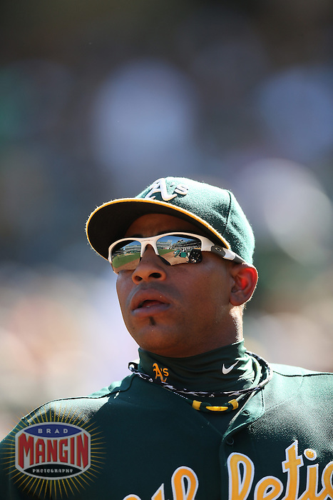 OAKLAND, CA - SEPTEMBER 30:  Yoenis Cespedes #52 of the Oakland Athletics takes the field against the Seattle Mariners during the game at O.co Coliseum on Sunday, September 30, 2012 in Oakland, California. Photo by Brad Mangin