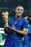 BERLIN - JULY 9:  Italy team captain Fabio Cannavaro holds the World Cup trophy after Italy defeated France in the 2006 FIFA World Cup final July 9, 2006 in Berlin, Germany.  Editorial use only.  Commercial use prohibited.  No push to mobile device usage.  (Photograph by  Jonathan Paul Larsen)