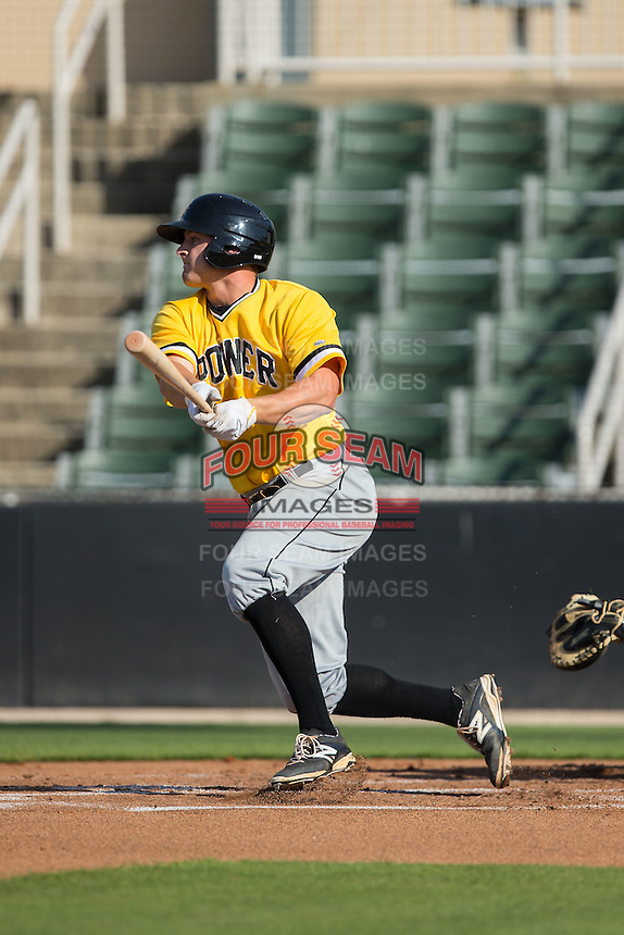 Jerrick Suiter (25) of the West Virginia Power follows through on his swing against the Kannapolis Intimidators at CMC-Northeast Stadium on April 21, 2015 in Kannapolis, North Carolina.  The Power defeated the Intimidators 5-3 in game one of a double-header.  (Brian Westerholt/Four Seam Images)