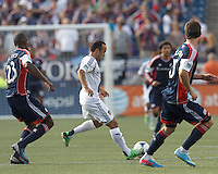 LA Galaxy forward Landon Donovan (10) passes the ball.  In a Major League Soccer (MLS) match, the New England Revolution (blue) defeated LA Galaxy (white), 5-0, at Gillette Stadium on June 2, 2013.