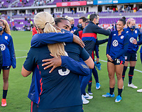 ORLANDO, FL - FEBRUARY 21: Catarina Macario #11 hugs Lindsey Horan #9 of the USWNT after a game between Brazil and USWNT at Exploria Stadium on February 21, 2021 in Orlando, Florida.