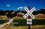 Crossing sign on Burlington Northern Sante Fe tracks along SR21 near Curlew in Washington State.  Curlew, often listed as a ghost town, is not.