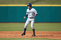 Conor Grammes (4) of the Xavier Musketeers takes his lead off of second base against the Penn State Nittany Lions at Coleman Field at the USA Baseball National Training Center on February 25, 2017 in Cary, North Carolina. The Musketeers defeated the Nittany Lions 10-4 in game one of a double header. (Brian Westerholt/Four Seam Images)