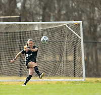 LOUISVILLE, KY - MARCH 13: Brooke Hendrix #15 of Racing Louisville FC kicks the ball up the field during a game between West Virginia University and Racing Louisville FC at Thurman Hutchins Park on March 13, 2021 in Louisville, Kentucky.