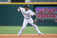 Charlotte Knights shortstop Leury Garcia (24) makes a throw to first base against the Norfolk Tides at BB&T BallPark on June 7, 2015 in Charlotte, North Carolina.  The Tides defeated the Knights 4-1.  (Brian Westerholt/Four Seam Images)