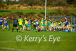 Gneeveguillas DJ Murphy been tackled by Ronan Kerins of   St Senans in the County Premier Junior football Quarter Final