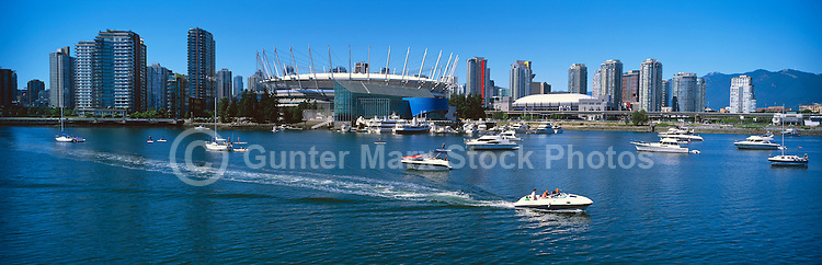 Vancouver, BC, British Columbia, Canada - Downtown City Skyline at False Creek with BC Place Stadium (New Retractable Roof completed in 2011), Edgewater Casino, and Rogers Arena - Panoramic View