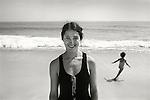 Lida Wild. 1973. Rehoboth Beach, Delaware. Kirsten running in background.  File #73-148-13