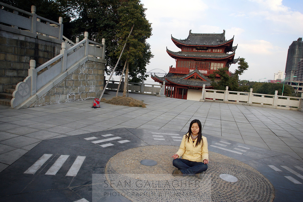 CHINA. Jiangxi Province.  Jiujiang. A woman at a buddhist temple on the banks of the Yangtze River. Jiujiang is a city of 4.6 million people, located on the southern shore of the Yangtze River. The Yangtze River is reported to be at its lowest level in 150 years as a result of a country-wide drought. It is China's longest river and the third longest in the world. Originating in Tibet, the river flows for 3,964 miles (6,380km) through central China into the East China Sea at Shanghai.  2008