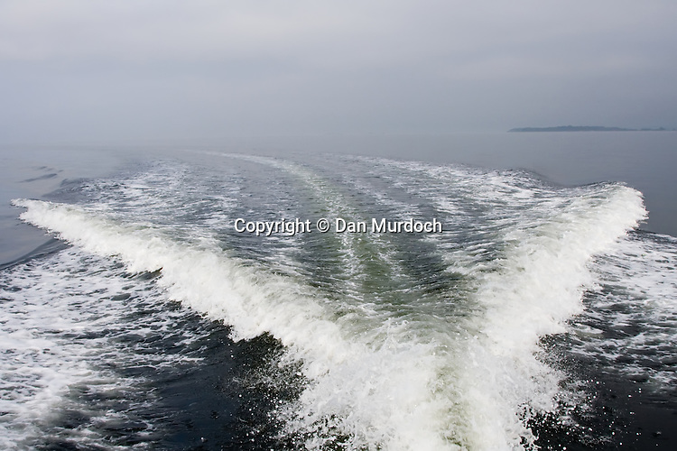 boat wake on a quiet morning