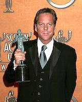 ©2004 KATHY HUTCHINS /HUTCHINS PHOTO.10TH ANNUAL SCREEN ACTORS GUILD AWARDS.PRESS ROOM.SHRINE AUDITORIUM.LOS ANGELES, CA.FEBRUARY 22, 2004..KIEFER SUTHERLAND