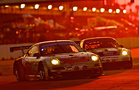 19 March 2011: A pair of Porsches race together at sunset during the 12 Hours of Sebring, Sebrng International Raceway, Sebring, FL. (Photo by Brian Cleary/www.bcpix.com)