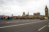 """London, 29/04/2017. Today, """"Campaign Against Climate Change"""" held a demonstration started at Old Palace Yard and ended on Westminster Bridge, where people formed a human chain showing the message: """"Trump & May Climate Disaster"""". The demonstration was in support and solidarity with the People's Climate March in the US (and over 350 other marches taking place across the globe) and to warn the British Prime Minister Theresa May to stop following Donald Trump """"down the path to climate disaster"""".<br />   <br /> For more information please click here: https://www.facebook.com/events/747422225425039/ & (Video) https://www.facebook.com/campaigncc/videos/1300562783385237/ & (Press Release) http://www.campaigncc.org/node/1782"""