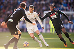 Cristiano Ronaldo of Real Madrid in action while fighting for the ball with Uche Henry Agbo of Granada CF during their La Liga match between Real Madrid and Granada CF at the Santiago Bernabeu Stadium on 07 January 2017 in Madrid, Spain. Photo by Diego Gonzalez Souto / Power Sport Images