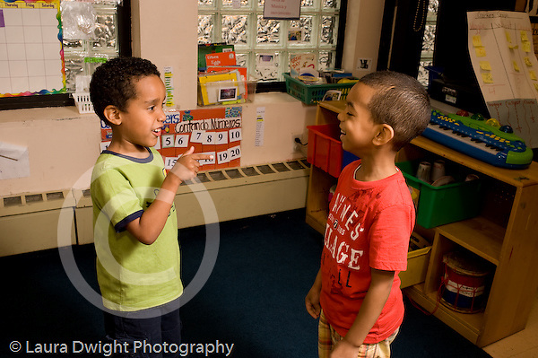 Preschool ages 3-5 two boys talking to each other happy horizontal
