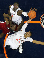 CHARLOTTESVILLE, VA- NOVEMBER 13: Akil Mitchell #25 of the Virginia Cavaliers and Assane Sene #5 of the Virginia Cavaliers reach for the loose ball with Omar Sanders #5 of the South Carolina State Bulldogs during the game on November 13, 2011 at the John Paul Jones Arena in Charlottesville, Virginia. Virginia defeated South Carolina State 75-38. (Photo by Andrew Shurtleff/Getty Images) *** Local Caption *** Omar Sanders;Assane Sene;Akil Mitchell