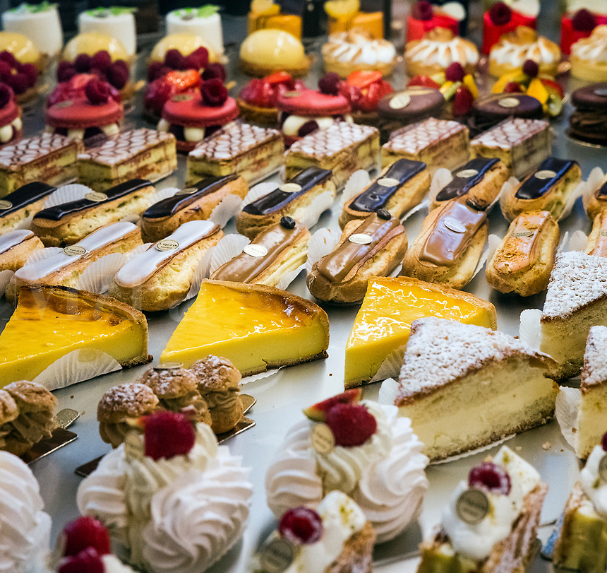 Sweet treats displayed in a French pastery shop.