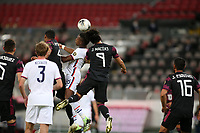 GUADALAJARA, MEXICO - MARCH 24: Andres Perea #15 of the United States goes up for a header with Jose Macias #9 of Mexico during a game between Mexico and USMNT U-23 at Estadio Jalisco on March 24, 2021 in Guadalajara, Mexico.